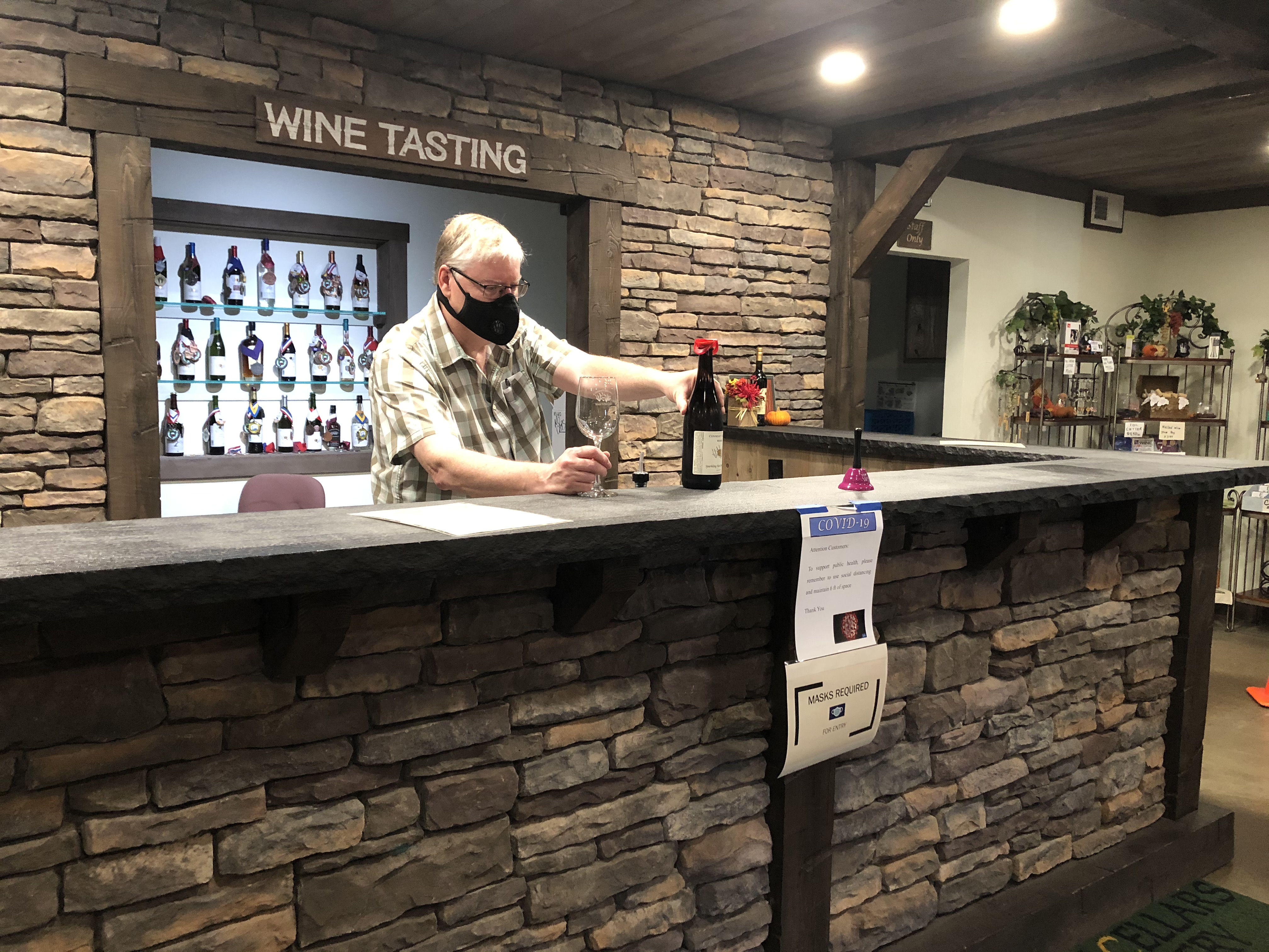 Joal Wolf, owner of Conneaut Cellars offering wine tasting at Conneaut Cellars Winery & Distillery.