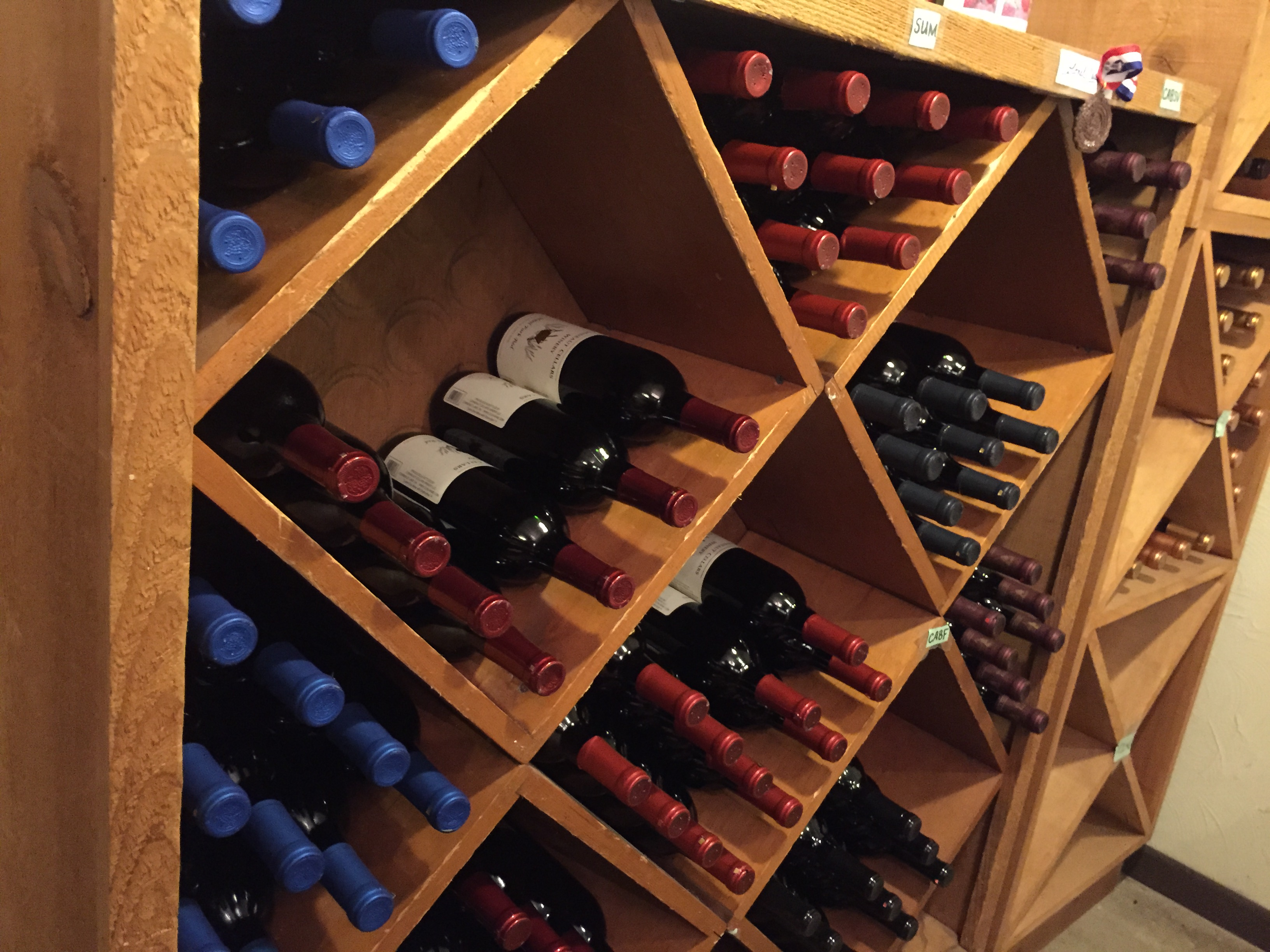 Various bottles of wine racked at Conneaut Cellars Winery & Distillery gift shop and tasting room.